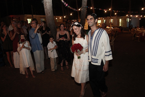 Walking down the aisle together. Photo by Gilad & Mazal Photography